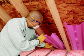 Attic Insulation being Installed